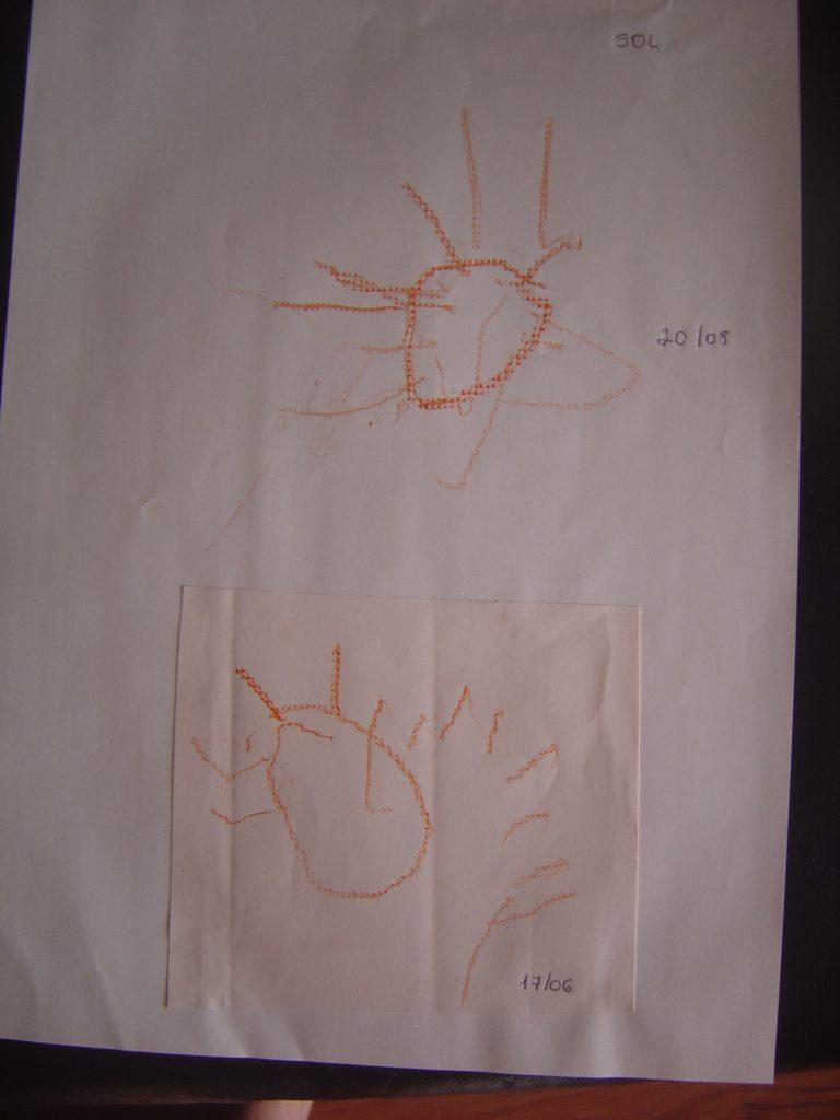 Foto 1: Desenho de um sol, na cor alaranjada feito por aluna com deficiência visual.